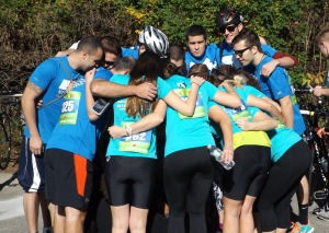 Members from Team ALKU huddle before the 2013 Rodman Ride for Kids